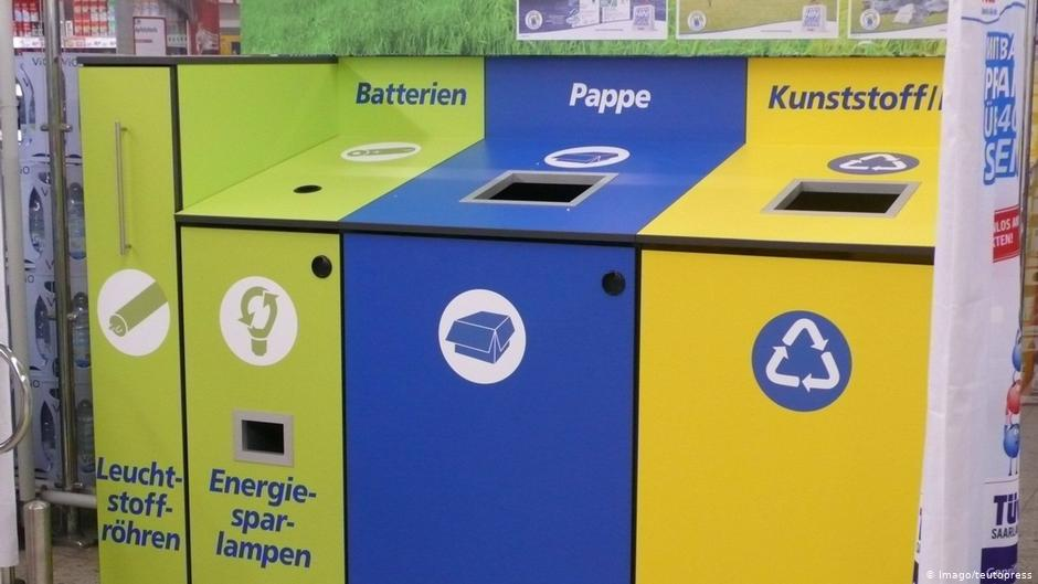 German supermarket. The second container on the left is for used batteries and energy-saving lamas
