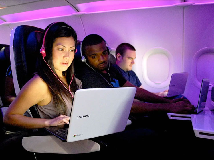Girl With The Laptop in an Airplane